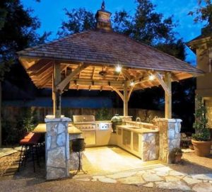 Nightime shot of outdoor kitchen with roof