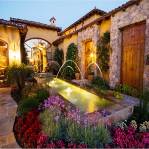 Nightime water feature and landscaping